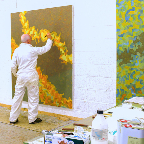 Abhayavajra Newman painting in his studio